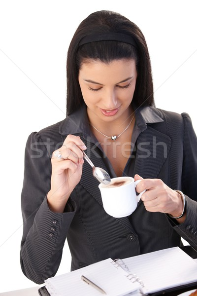 Stock photo: Businesswoman enjoying cappuccino