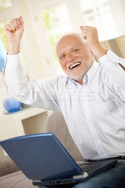 623497_stock-photo-old-man-celebrating-w