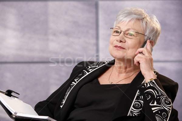 Stock photo: Senior businesswoman using mobile phone