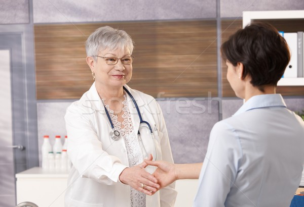 Stock photo: Doctor with patient