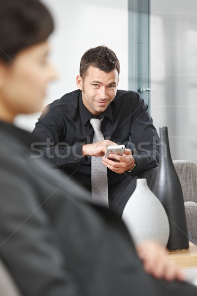 Stock photo: Businessman using palmtop