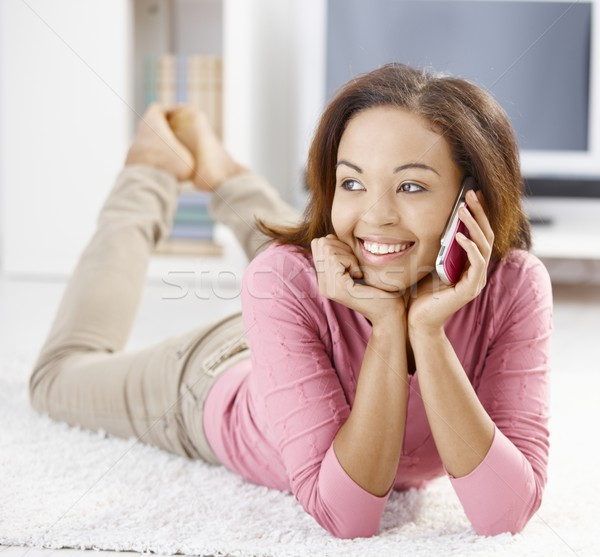 Stock photo: Happy afro girl with mobile phone