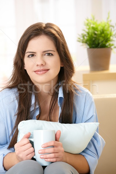 Stock photo: Girl with coffee and pillow