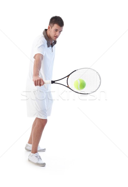 Stock photo: Tennis player doing backhand stroke