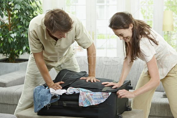 Stock photo: Closing suitcase