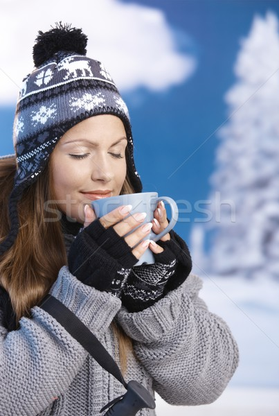 Stock photo: Pretty girl drinking hot tea in winter eyes closed