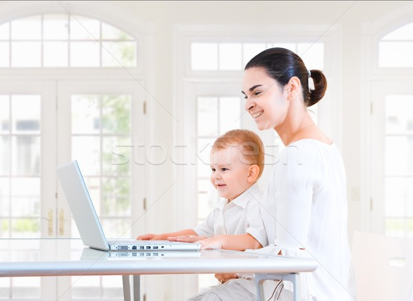 Stock photo: Mother and baby using laptop