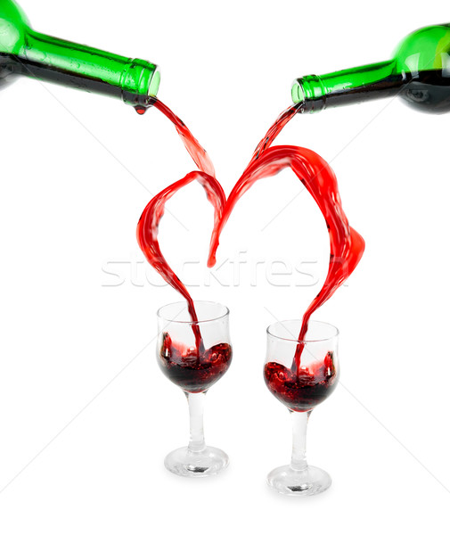 Stock photo: Heart from pouring red wine
