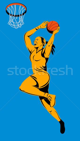 Female basketball player dunking