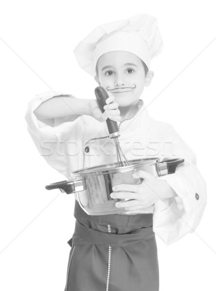 Stock photo: Little chef with kitchen utensil cooking