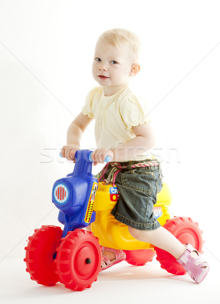 Stock photo: little girl on toy motorcycle