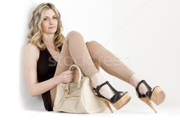 Stock photo: sitting woman wearing summer clothes and shoes with a handbag