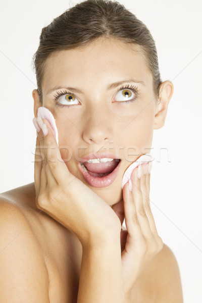 Stock photo: portrait of young woman with cotton pads