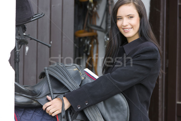 Stock photo: portrait of equestrian with saddle