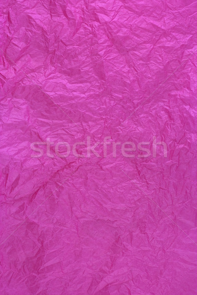 dark pink tissue wrapping paper texture, crumpled and wrinkled