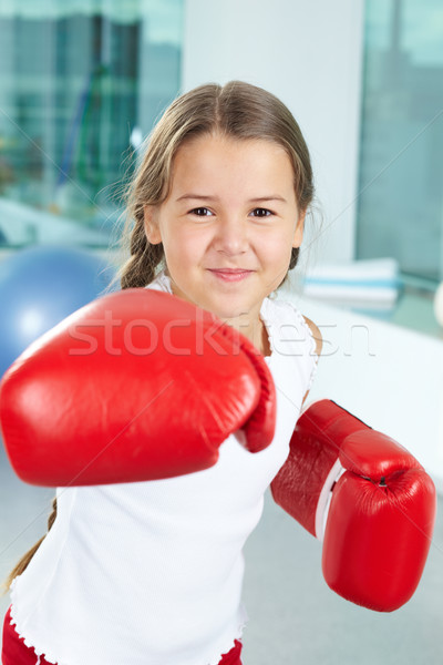 Stock photo: Girl in boxing gloves
