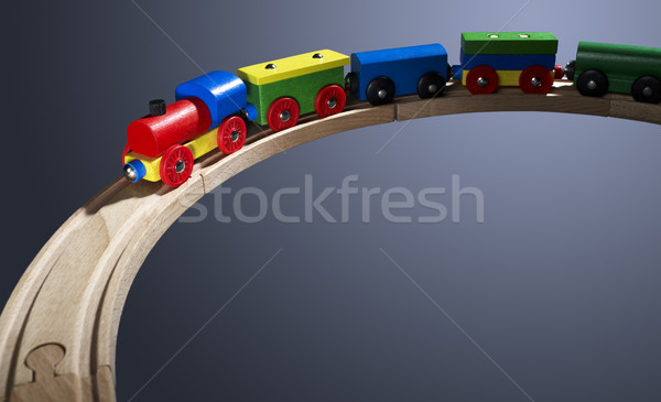 Stock photo: colorful wooden toy train on tracks
