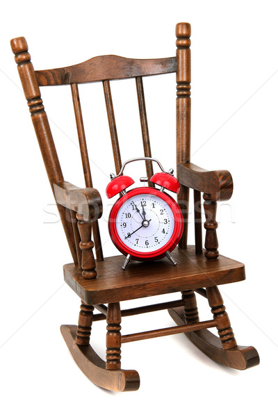 1315609 old wooden rocking chair and red alarm bell on white by