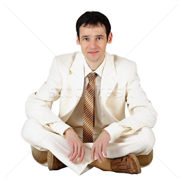 Stock photo: Business man sitting on a white