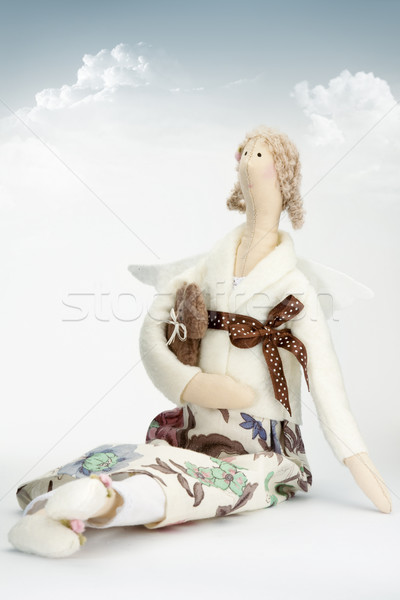 Stock photo: Doll with teddy bear