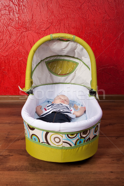 Stock photo: Baby Sleeping in a Stroller