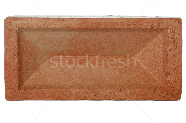 Red brick against a white background.