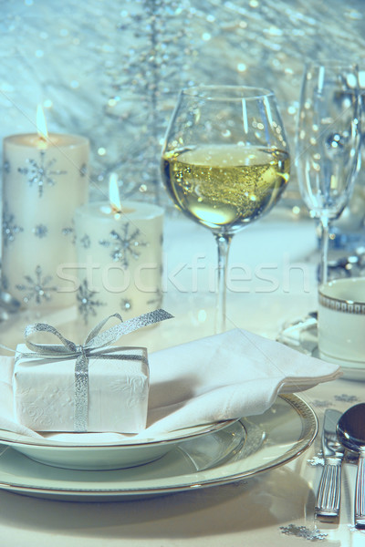 Festive holiday dinner setting with gift for the holidays