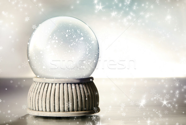 Stock photo: Snow globe against a silver background