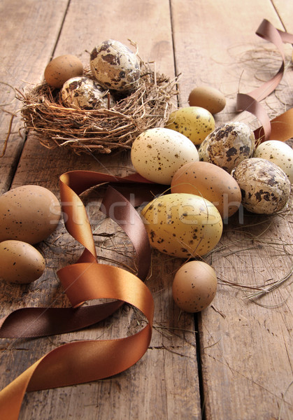 Stock photo: Brown and yellow eggs with ribbons for easter