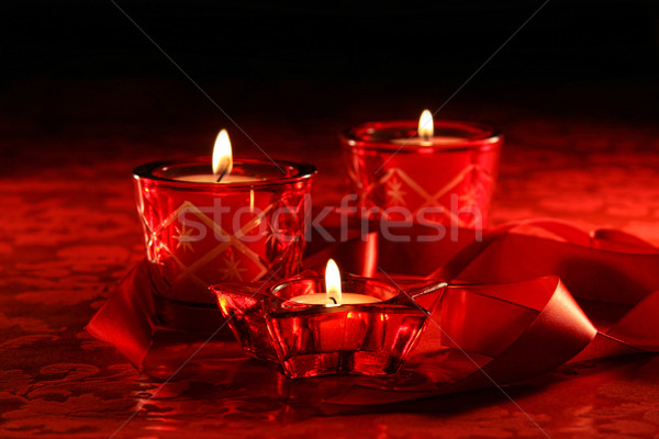 Stock photo: Votive candles on dark red background