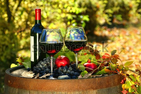 Stock photo: Glasses of red wine on old barrel