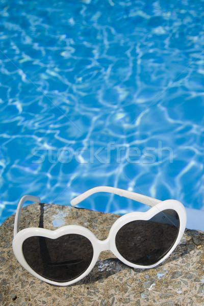 Sunglasses by the Pool stock photo © Alex Bramwell ...