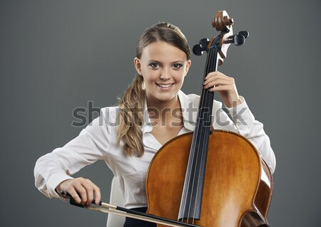 Portrait of a beautiful female violinist, musicians on background