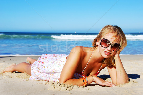 Stock photo: Young woman enjoying summer on the beach
