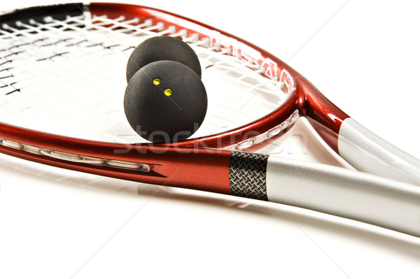 Stock photo: Close up of a red and silver squash racket and ball