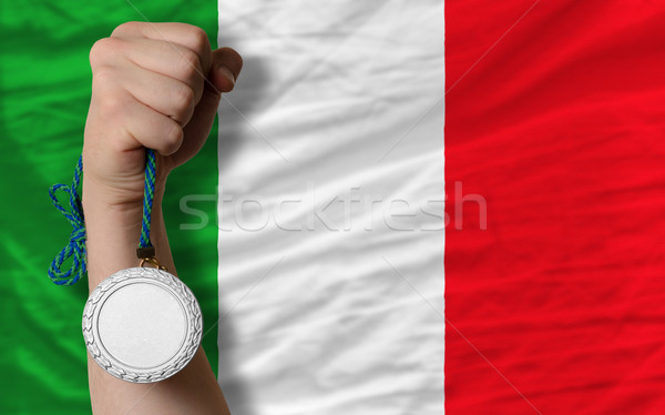 Holding silver medal for sport and national flag of italy