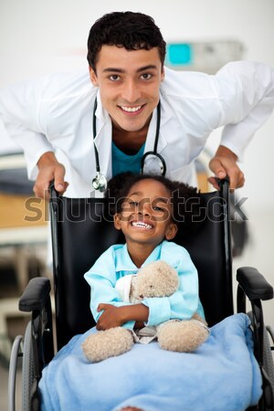 Young child being cared for by a doctor in a hospital