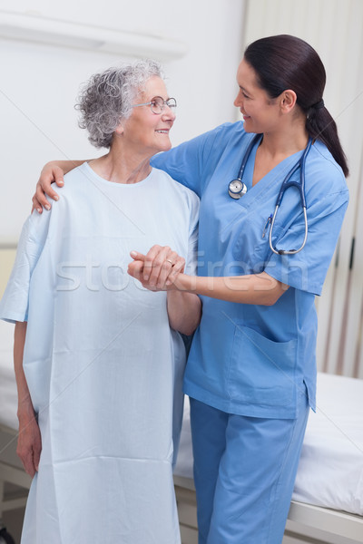 Stock photo: Nurse assisting an elderly patient in hospital ward