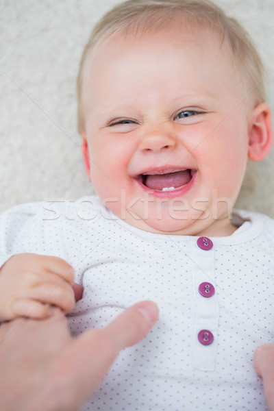 Baby smiling in living room