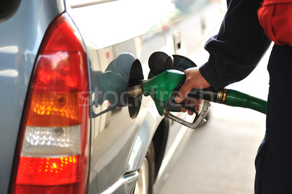 Stock photo: Man refilling the car with fuel on a filling station