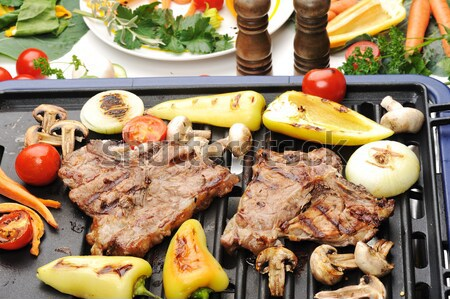 Stock photo: Barbecue, prepared beef meat and different vegetables and mushrooms on grill