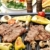 Stock photo: barbecue prepared beef meat and different vegetables and mushrooms on grill